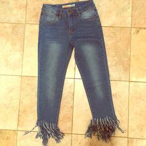 Vintage Havana jeans with fringed denim cuffs.